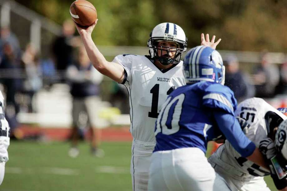 Wilton QB Brett Phiilips firses the ball down field against Darien in first quarter action between the two schools. © J. Gregory Raymond Photo: J. Gregory Raymond / Stamford Advocate Freelance