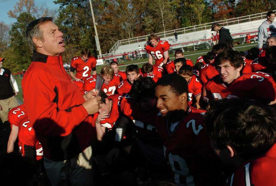 Highlights from boys football action between New Canaan and St. Joseph in New Canaan, Conn. on Saturday October 22, 2011. New Canaan Head Coach Lou Marinelli talks to his team after completing his 250th win. Photo: Christian Abraham / Connecticut Post