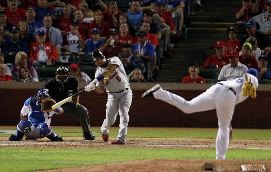 St. Louis Cardinals' Albert Pujols hits a home run during the ninth inning of Game 3 of baseball's World Series against the Texas Rangers Saturday, Oct. 22, 2011, in Arlington, Texas. The home run was Pujols' third of the game. (AP Photo/Eric Gay) Photo: Eric Gay, Associated Press / AP