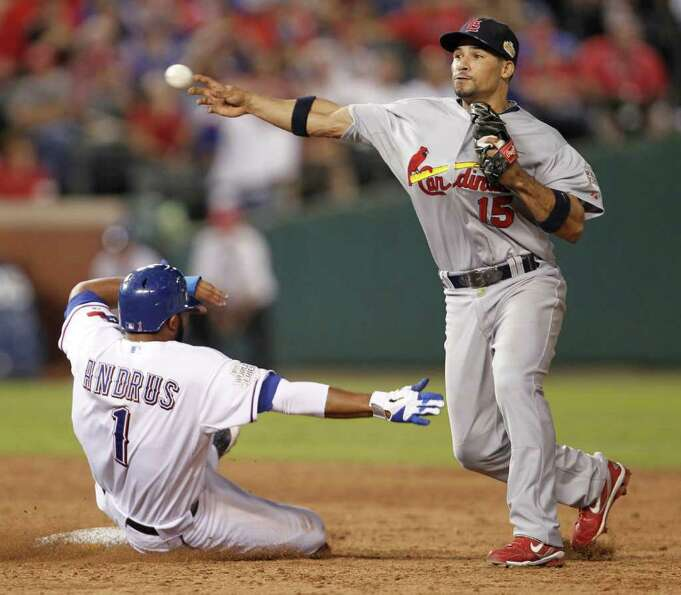 Texas Rangers' Elvis Andrus (1) is doubled up at second base by St. Louis Cardinals shortstop Rafael