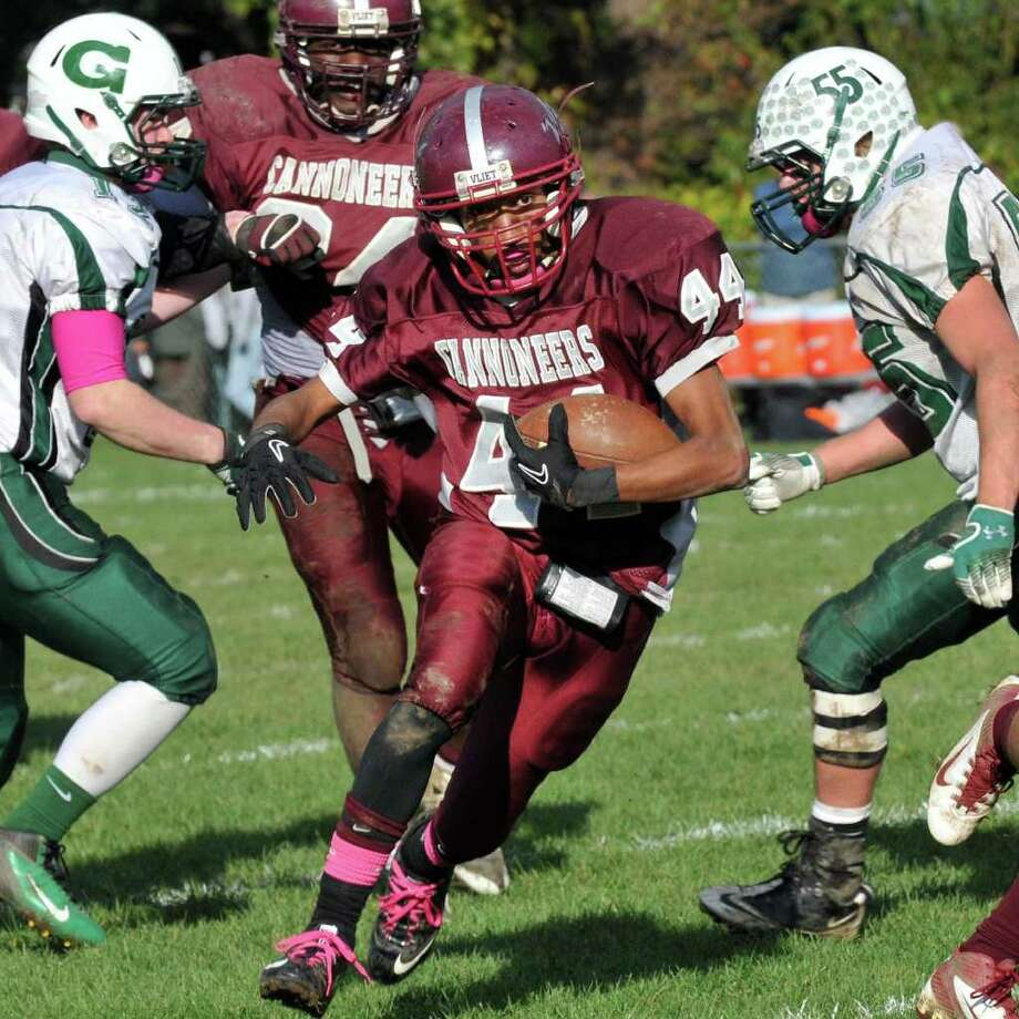 Watervliet's #44 Nick Brown runs through a Greenwich defense during a Class C quarterfinal football game at Watervliet Saturday October 22, 2011.   (John Carl D'Annibale / Times Union) Photo: John Carl D'Annibale / 00015046A