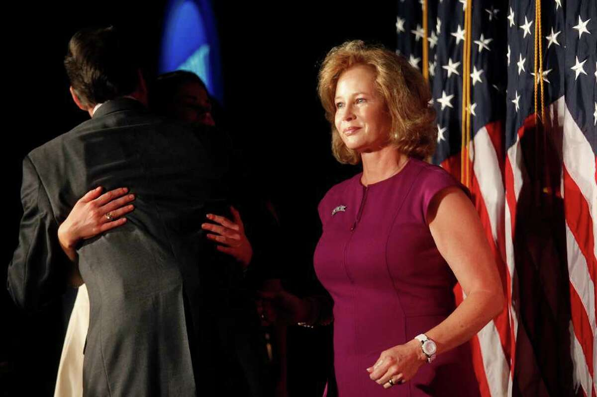Anita Perry stands by as her husband, Governor Rick Perry, embraces their daughter after he gave a speech officially declaring his run for President of the United States at the RedState Gathering in Charleston, SC on Saturday, August 13, 2011.