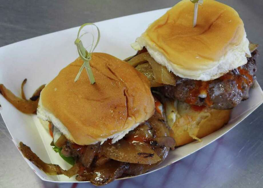 Say She Ate, food truck at various locations, follow Say.She.Ate TX on Facebook: Two Akaushi beef sliders are topped with caramelized onions, garlic aioli and blue cheese on a sweet Hawaiian bread bun. www.saysheatetx.com Photo: BILLY CALZADA, Express-News / gcalzada@express-news.net