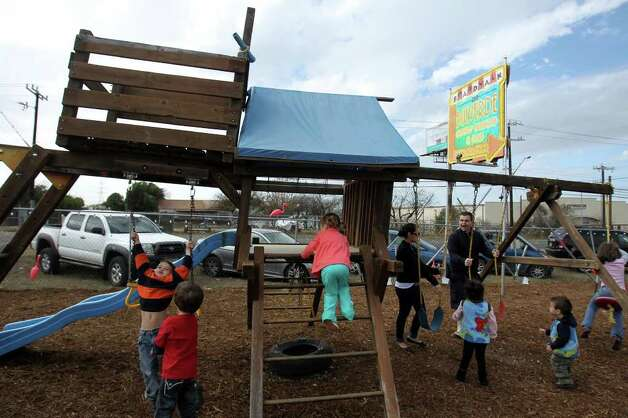 Children play on the jungle gym at the grand opening of Boardwalk on Bulverde, San Antonio's first mobile food truck park, Saturday, January 8, 2011. Photo: JENNIFER WHITNEY, Express-News / special to the Express-News