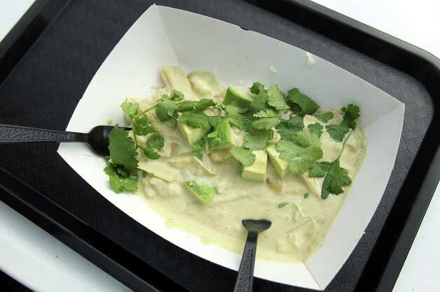 Green curry from the Duk Truck, Jason Dady's mobile debut, during the grand opening of Boardwalk on Bulverde, San Antonio's first mobile food truck park, Saturday, January 8, 2011. Photo: JENNIFER WHITNEY, Express-News / special to the Express-News