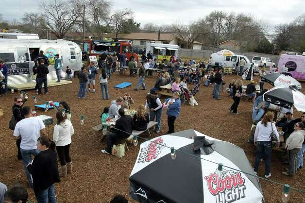 Hundreds of people showed up for the grand opening of Boardwalk on Bulverde, San Antonio's first mobile food truck park, Saturday, January 8, 2011. Photo: JENNIFER WHITNEY, Express-News / special to the Express-News
