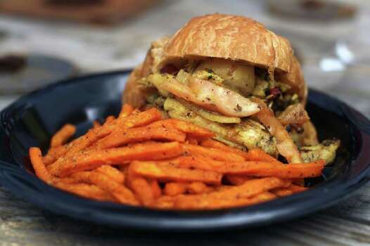 A chicken sandwich with sweet potato fries from Wheelie Gourmet. Photo: JENNIFER WHITNEY, Express-News / special to the Express-News