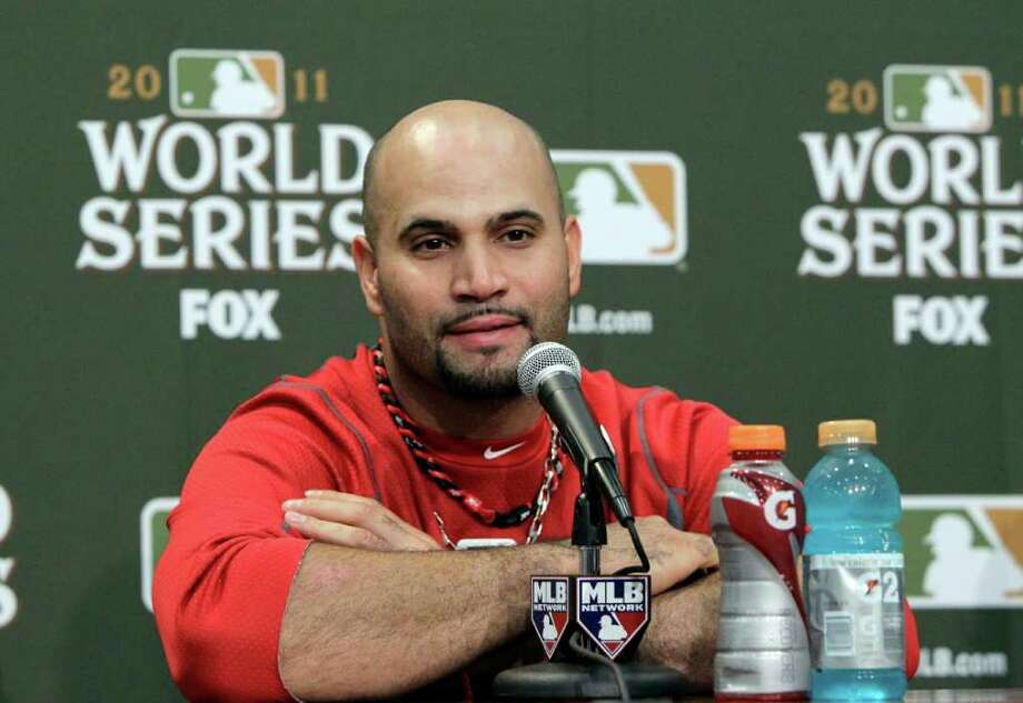 St. Louis Cardinals' Albert Pujols listens to a question during a news conference after Game 3 of baseball's World Series against the Texas Rangers, Saturday, Oct. 22, 2011, in Arlington, Texas. Pujols hit three home runs to tie the World Series record in a 16-7 Cardinals victory. (AP Photo/Tony Gutierrez) Photo: Tony Gutierrez / AP