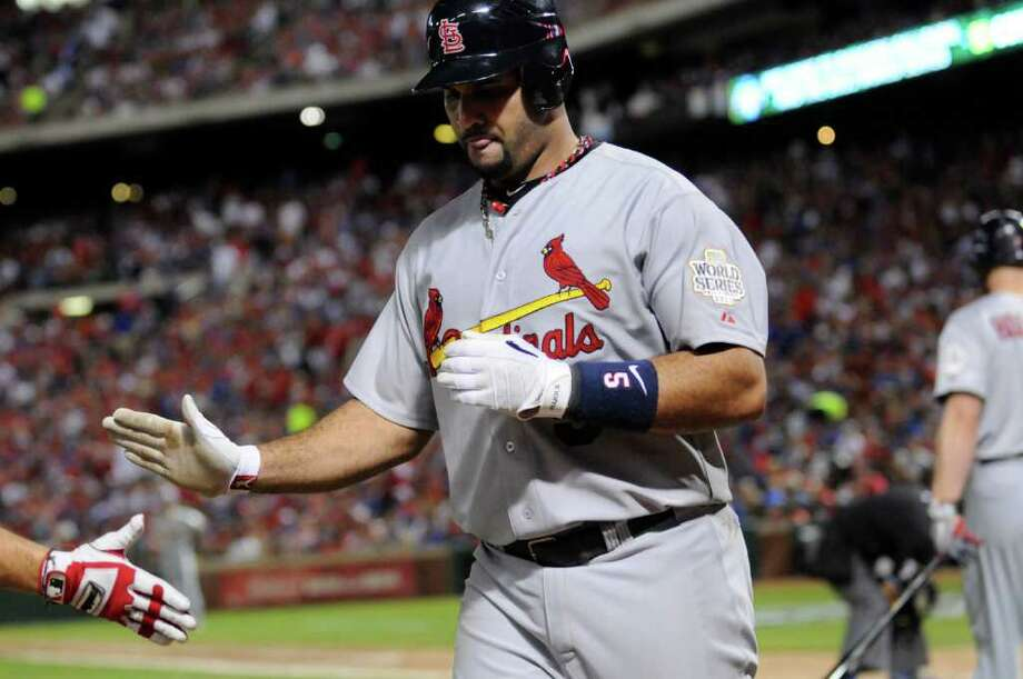 St. Louis Cardinals' Albert Pujols gets congratulated after hitting his second of three home runs in Game 3 of the World Series against the Texas Rangers at Rangers Ballpark in Arlington on Saturday, October 22, 2011, in Arlington, Texas. The Cardinals took a 2-1 series lead with a 16-7 victory. (Max Faulkner/Fort Worth Star-Telegram/MCT) Photo: Max Faulkner / Fort Worth Star-Telegram