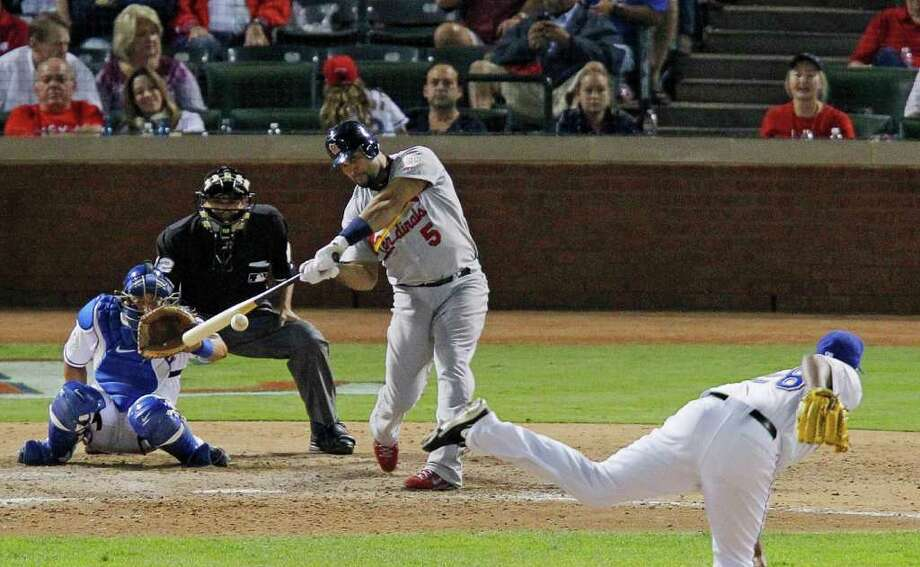 St. Louis Cardinals' Albert Pujols (5) hits a solo home run in the ninth inning off of Texas Rangers relief pitcher Darren Oliver, his third home run in Game 3 of the World Series at Rangers Ballpark in Arlington on Saturday, October 22, 2011, in Arlington, Texas. The Cardinals took a 2-1 series lead with a 16-7 victory. (Rodger Mallison/Fort Worth Star-Telegram/MCT) Photo: Rodger Mallison / Fort Worth Star-Telegram