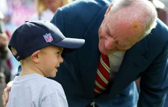 Houston Texans owner Bob McNair, right, talks to Drake Dixon, 6, before an NFL football game against the Tennessee Titans at LP Field Sunday, Oct. 23, 2011, in Nashville. Photo: Brett Coomer, Houston Chronicle / © 2011  Houston Chronicle