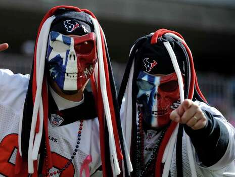 Houston Texans fans cheer before an NFL football game between the Houston Texans and the Tennessee Titans on Sunday, Oct. 23, 2011, in Nashville, Tenn. (AP Photo/Frederick Breedon) Photo: Frederick Breedon, Associated Press / FR159542 AP