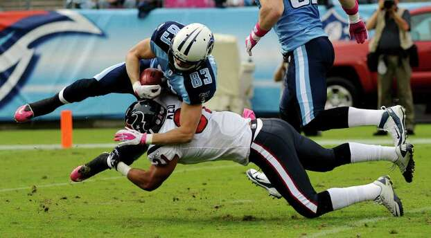 Houston Texans' Shiloh Keo stops Tennessee Titans' Marc Mariani (83) as Mariani runs back a kickoff in the first quarter of an NFL football game Sunday, Oct. 23, 2011, in Nashville, Tenn. (AP Photo/Frederick Breedon) Photo: Frederick Breedon, Associated Press / FR159542 AP