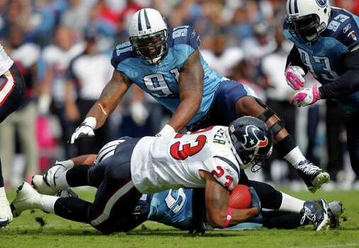 Tennessee Titans defensive tackle Jason Jones (91) helps stop Houston Texans running back Arian Foster (23) in the first quarter of an NFL football game Sunday, Oct. 23, 2011, in Nashville, Tenn. (AP Photo/Wade Payne) Photo: Wade Payne, Associated Press / FR23601 AP