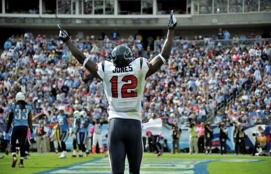 Houston Texans wide receiver Jacoby Jones celebrates after the Texans scored a touchdown against the Tennessee Titans in the second quarter of an NFL football game on Sunday, Oct. 23, 2011, in Nashville, Tenn. (AP Photo/Frederick Breedon) Photo: Frederick Breedon, Associated Press / FR159542 AP