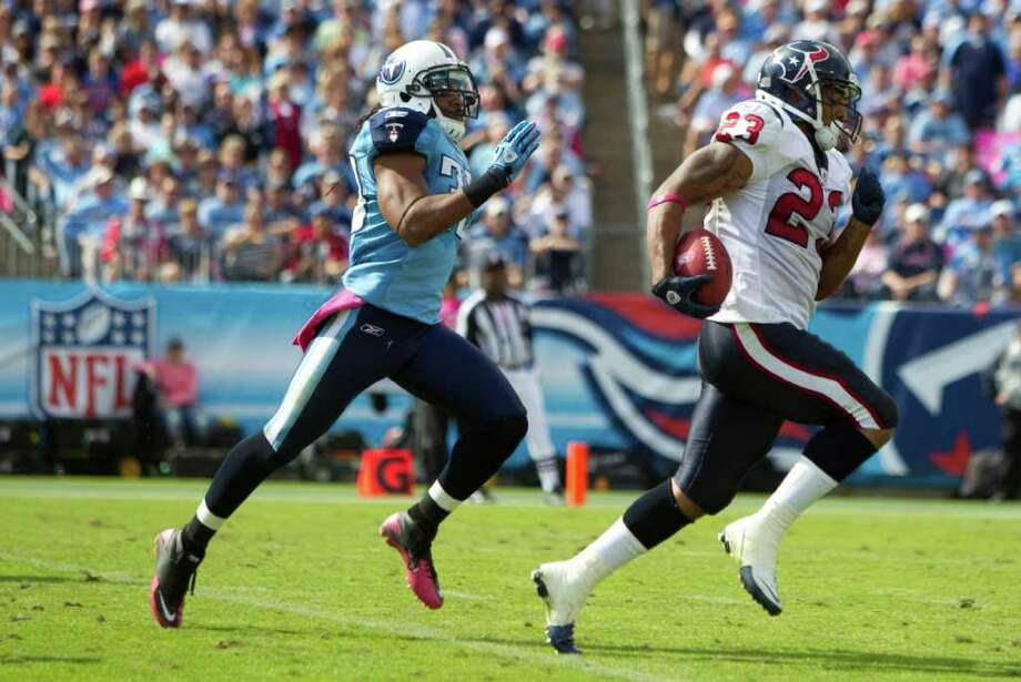 Oct. 23: Texans 41, Titans 7.Texans running back Arian Foster (23) runs away from Tennessee Titans free safety Michael Griffin (33) on a 78-yard touchdown reception during the second quarter of an NFL football game at LP Field Sunday, Oct. 23, 2011, in Nashville. Photo: Brett Coomer, Houston Chronicle / © 2011  Houston Chronicle