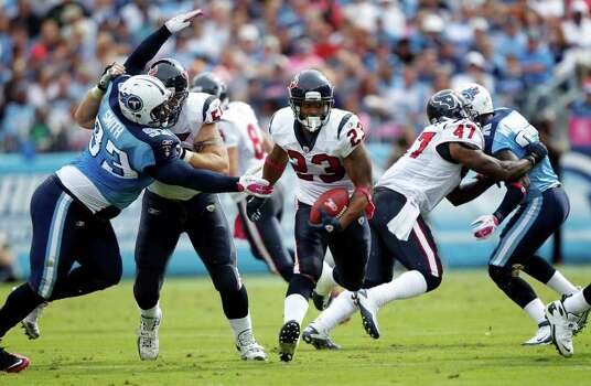 Houston Texans running back Arian Foster (23) runs through a hole created by Chris Myers (55) and Lawrence Vickers (47) against the Tennessee Titans in the second quarter of an NFL football game Sunday, Oct. 23, 2011, in Nashville, Tenn. (AP Photo/Wade Payne) Photo: Wade Payne, Associated Press / FR23601 AP