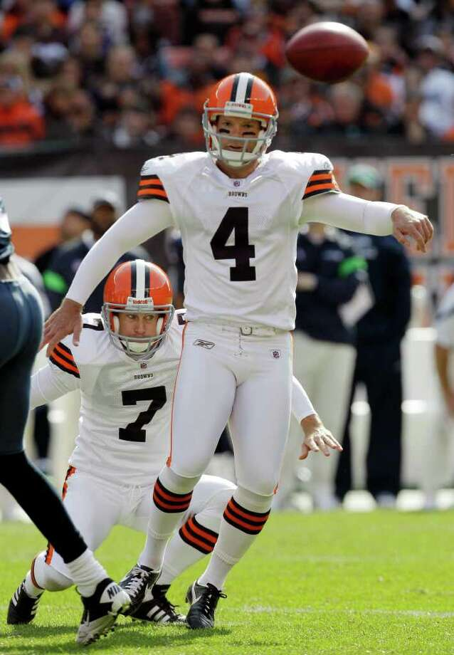 Cleveland Browns kicker Phil Dawson (4) and holder Brad Maynard (7) watch the ball after Dawson's field goal attempt was blocked by the Seattle Seahawks in the second quarter of an NFL football game Sunday, Oct. 23, 2011, in Cleveland. Photo: AP