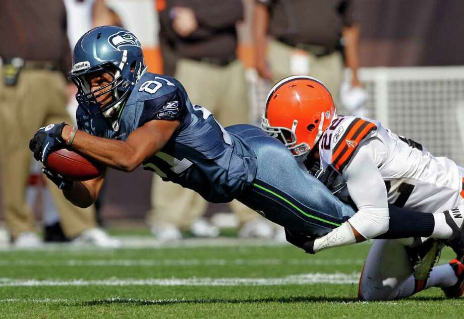 Seattle Seahawks wide receiver Golden Tate (81) is tackled by Cleveland Browns cornerback Buster Skrine in the second quarter of an NFL football game Sunday, Oct. 23, 2011, in Cleveland. Photo: AP