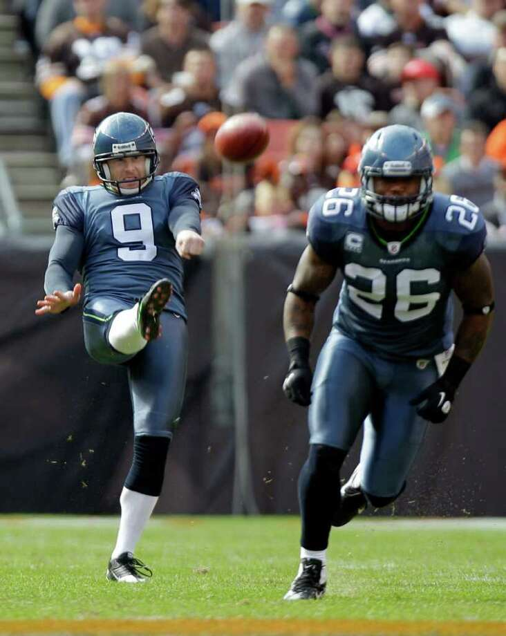 Seattle Seahawks' Jon Ryan (9) punts as Michael Robinson (26) runs to cover in the first quarter of an NFL football game against the Cleveland Browns Sunday, Oct. 23, 2011, in Cleveland. Photo: AP