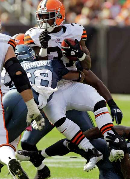 Cleveland Browns running back Montario Hardesty is tackled by Seattle Seahawks cornerback Walter Thu