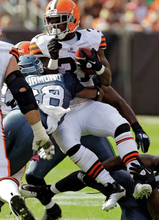 Cleveland Browns running back Montario Hardesty is tackled by Seattle Seahawks cornerback Walter Thurmond (28) in the first quarter of an NFL football game Sunday, Oct. 23, 2011, in Cleveland. Photo: AP