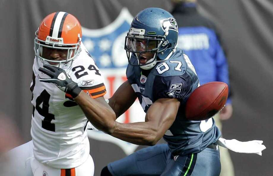 Cleveland Browns cornerback Sheldon Brown (24) breaks up a pass intended for Seattle Seahawks wide receiver Ben Obomanu (87) in the first quarter of an NFL football game Sunday, Oct. 23, 2011, in Cleveland. Photo: AP