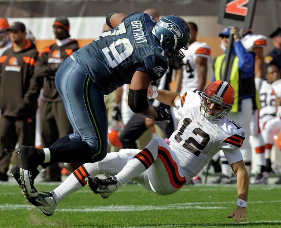 Seattle Seahawks defensive end Red Bryant (79) knocks down Cleveland Browns quarterback Colt McCoy (12) after an incomplete pass in the first quarter of an NFL football game Sunday, Oct. 23, 2011, in Cleveland. Photo: AP