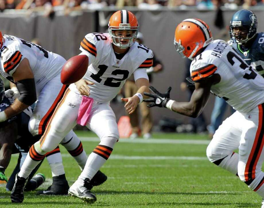 Cleveland Browns quarterback Colt McCoy (12) pitches to running back Montario Hardesty in the first quarter of an NFL football game against the Seattle Seahawks Sunday, Oct. 23, 2011, in Cleveland. Photo: AP