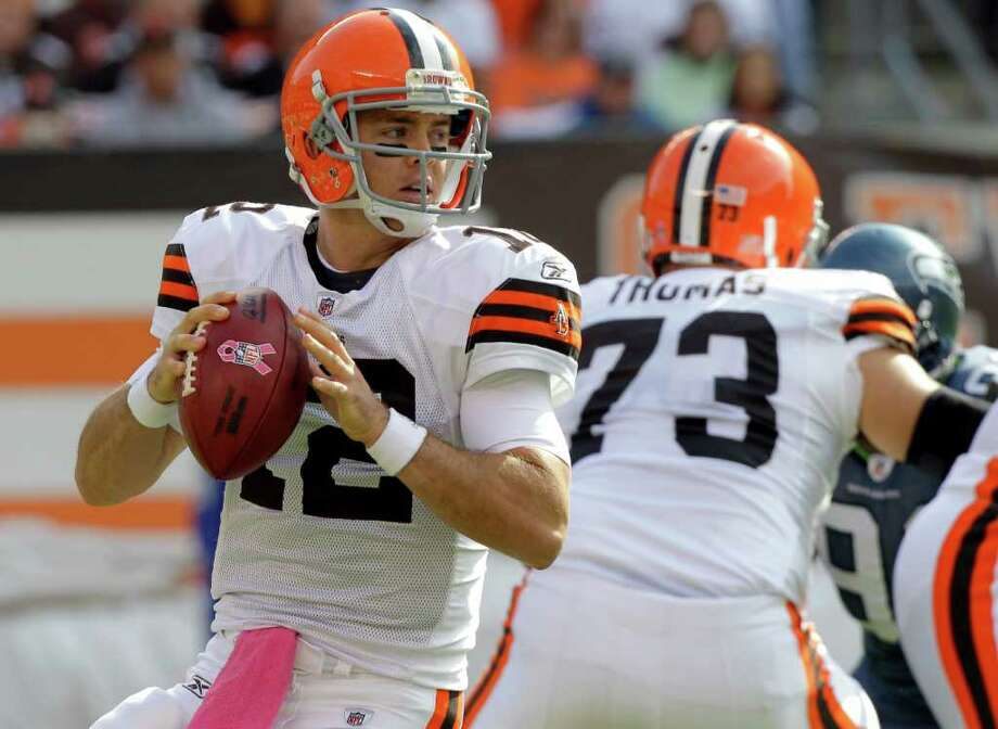 Cleveland Browns quarterback Colt McCoy, left, drops back to pass against the Seattle Seahawks during the first quarter in an NFL football game on Sunday, Oct. 23, 2011, in Cleveland. Photo: AP