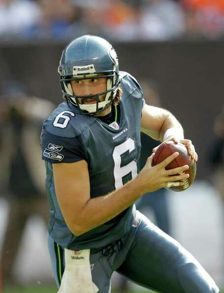 Seattle Seahawks quarterback Charlie Whitehurst rolls out against the Cleveland Browns- in the first