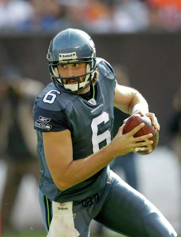 Seattle Seahawks quarterback Charlie Whitehurst rolls out against the Cleveland Browns- in the first quarter of an NFL football game Sunday, Oct. 23, 2011, in Cleveland. Photo: AP