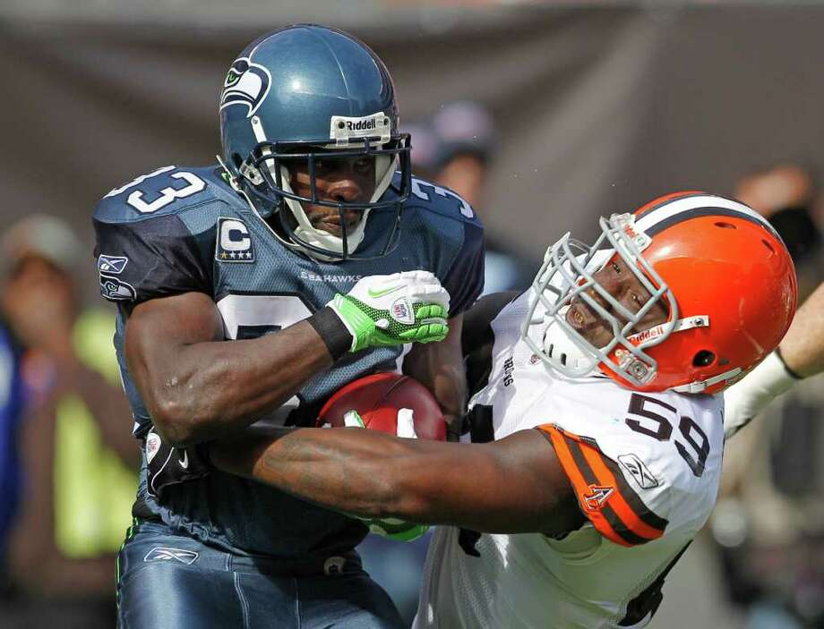 Seattle Seahawks running back Leon Washington, left, is tackled by Cleveland Browns linebacker Titus Brown (59) on the opening kickoff in an NFL football game on Sunday, Oct. 23, 2011, in Cleveland. Photo: AP