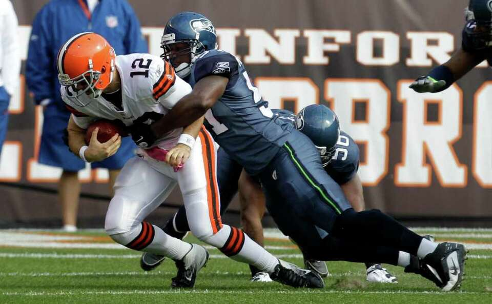Cleveland Browns quarterback Colt McCoy (12) is sacked by Seattle Seahawks middle linebacker David H