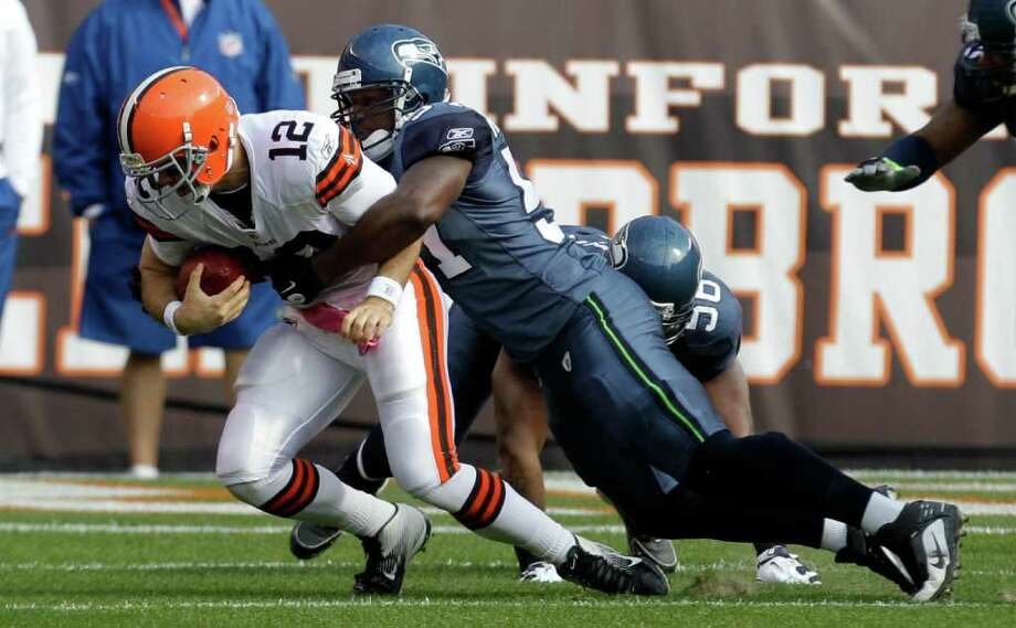 Cleveland Browns quarterback Colt McCoy (12) is sacked by Seattle Seahawks middle linebacker David Hawthorne in the first quarter of an NFL football game Sunday, Oct. 23, 2011, in Cleveland. Photo: AP