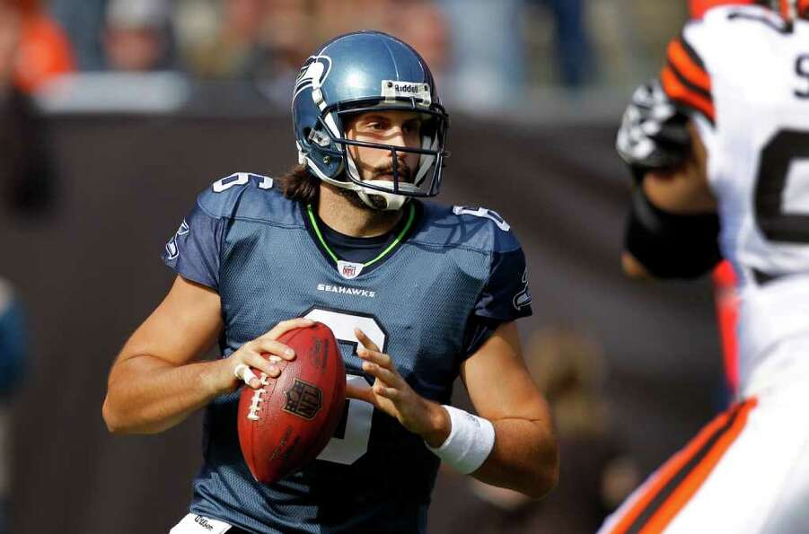 Seattle Seahawks quarterback Charlie Whitehurst looks to pass against the Cleveland Browns in the fi