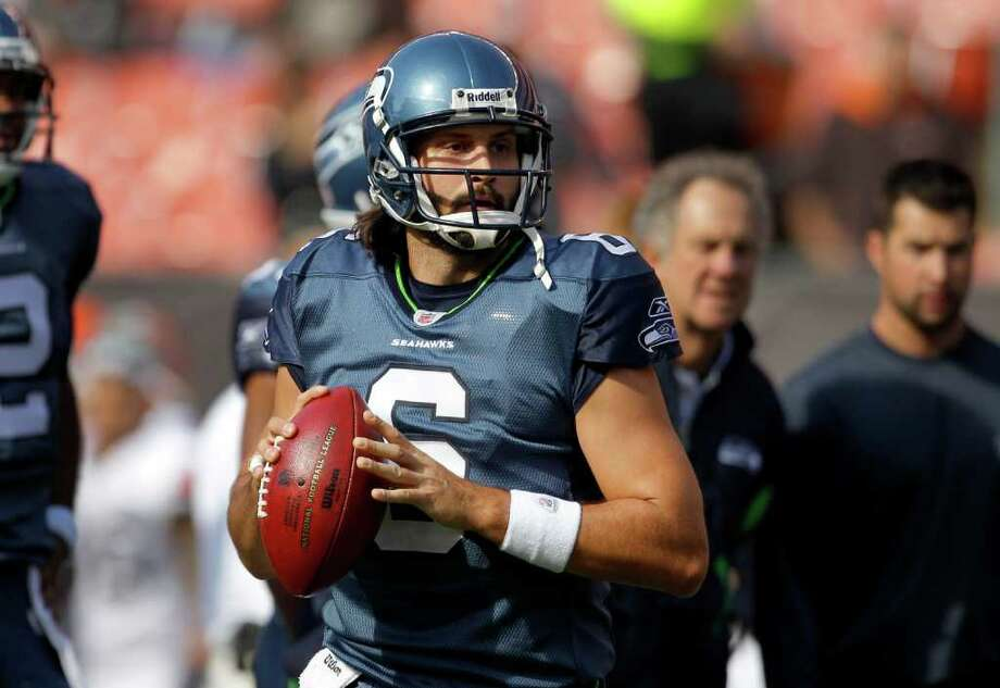 Seattle Seahawks quarterback Charlie Whitehurst looks to pass during pre-game warmups before facing the Cleveland Browns in an NFL football game on Sunday, Oct. 23, 2011, in Cleveland. Photo: AP
