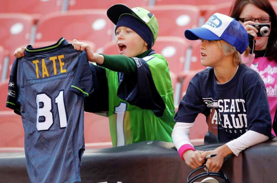 Young Seattle Seahawks fans yell out to their team during pre-game warmups before they faced the Cleveland Browns in an NFL football game on Sunday, Oct. 23, 2011, in Cleveland. Photo: AP