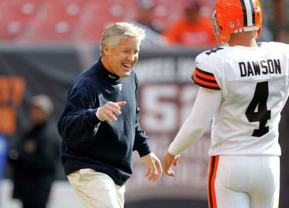 Seattle Seahawks head coach Pete Carroll greets Cleveland Browns kicker Phil Dawson before their teams face off in an NFL football game on Sunday, Oct. 23, 2011, in Cleveland. Photo: AP