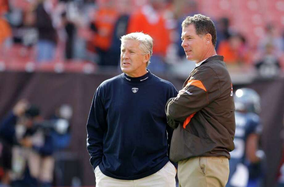 Seattle Seahawks head coach Pete Carroll, left, talks with Cleveland Browns head coach Pat Shurmur before the start of an NFL football game on Sunday, Oct. 23, 2011, in Cleveland. Photo: AP