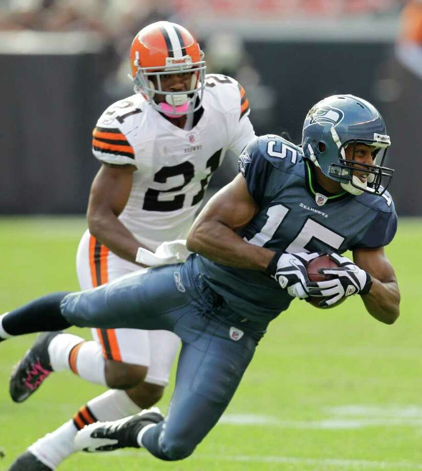 Seattle Seahawks wide receiver Doug Baldwin (15) catches a pass under pressure from Cleveland Browns defensive back Dimitri Patterson (21) in the second quarter in an NFL football game Sunday, Oct. 23, 2011, in Cleveland. Photo: AP