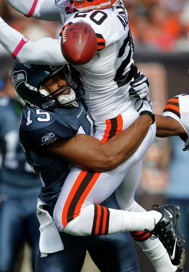 Seattle Seahawks wide receiver Doug Baldwin (15) tackles Cleveland Browns cornerback Mike Adams (20) after he broke up a pass in the second quarter in an NFL football game on Sunday, Oct. 23, 2011, in Cleveland. Photo: AP