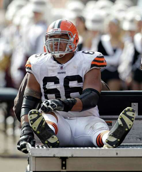 Cleveland Browns guard Shawn Lauvao leaves after an injury in the second quarter in an NFL football