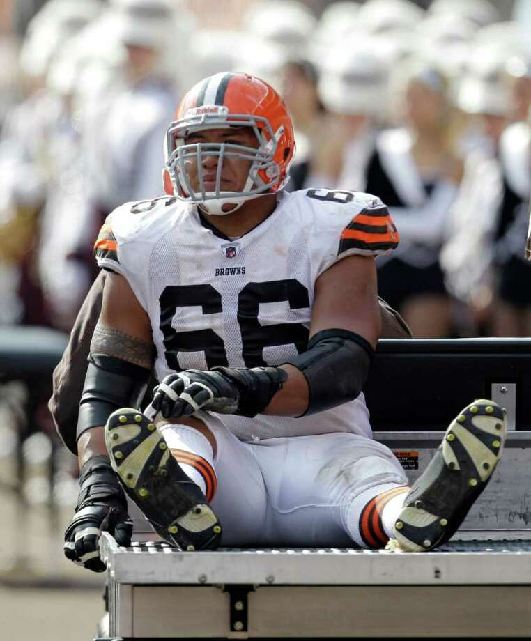 Cleveland Browns guard Shawn Lauvao leaves after an injury in the second quarter in an NFL football game against the Seattle Seahawks Sunday, Oct. 23, 2011, in Cleveland. Photo: AP