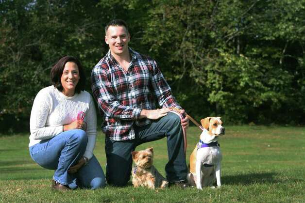 Newly engaged couple, Carissa Mason and Matt Bernardo, of Stratford, are trying to establish a dog park in Stratford on Sunday, October, 23, 2011. They hope to raise the funds and only ask the town to donate the land. With the couple are their dogs, Veda, left, and Kaiya. Photo: B.K. Angeletti / Connecticut Post