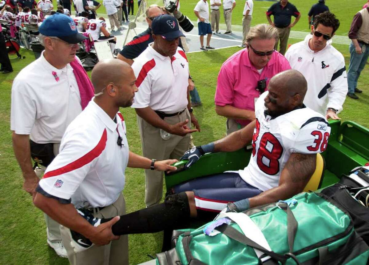 Houston Texans free safety Danieal Manning (38) is taken to a cart after injuring his leg during the second quarter of an NFL football game against the Tennessee Titans at LP Field Sunday, Oct. 23, 2011, in Nashville. The Texans beat the Titans 41-7.