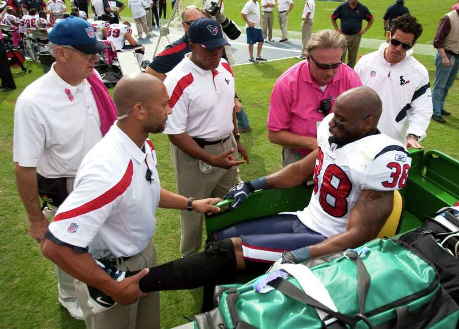 Houston Texans free safety Danieal Manning (38) is taken to a cart after injuring his leg during the second quarter of an NFL football game against the Tennessee Titans at LP Field Sunday, Oct. 23, 2011, in Nashville. The Texans beat the Titans 41-7. Photo: Brett Coomer, Houston Chronicle / © 2011  Houston Chronicle