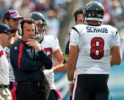 Houston Texans head coach Gary Kubiak talks with quarterback Matt Schaub (8) during a timeout in the second quarter of an NFL football game at LP Field Sunday, Oct. 23, 2011, in Nashville. Photo: Brett Coomer, Houston Chronicle / © 2011  Houston Chronicle
