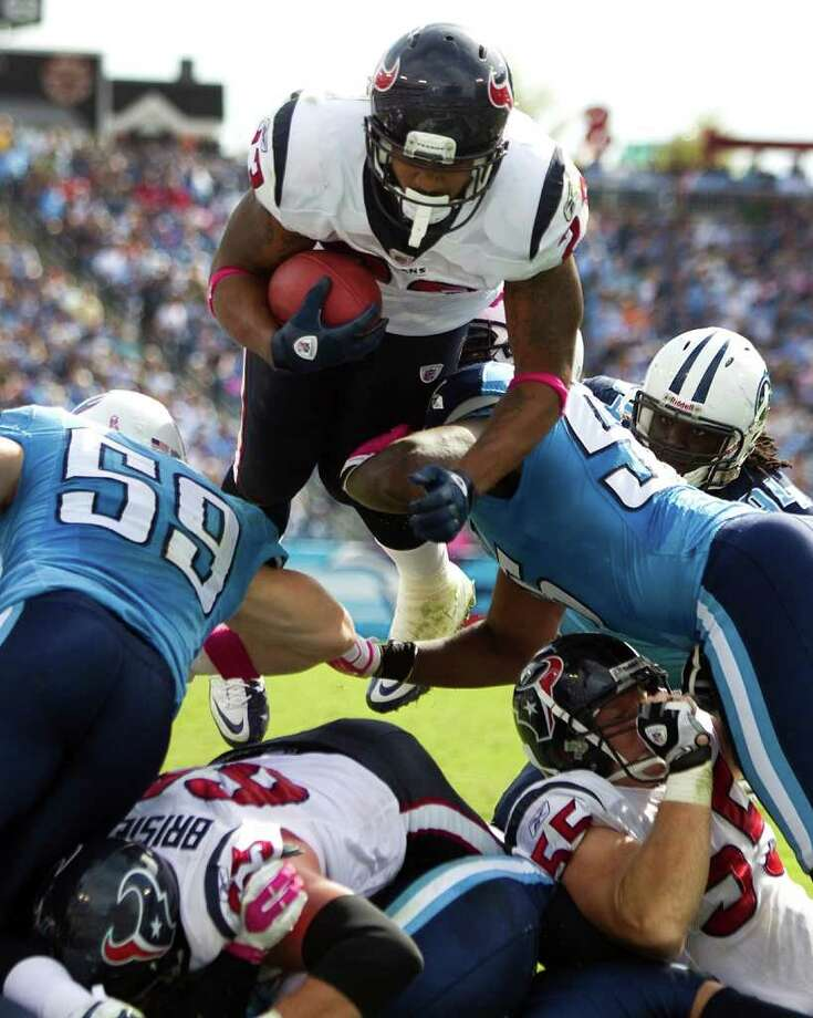 Houston Texans running back Arian Foster (23) dives over the goal line for a 1-yard touchdown run against the Tennessee Titans during the third quarter of an NFL football game at LP Field Sunday, Oct. 23, 2011, in Nashville. The Texans beat the Titans 41-7. Photo: Brett Coomer, Houston Chronicle / © 2011  Houston Chronicle