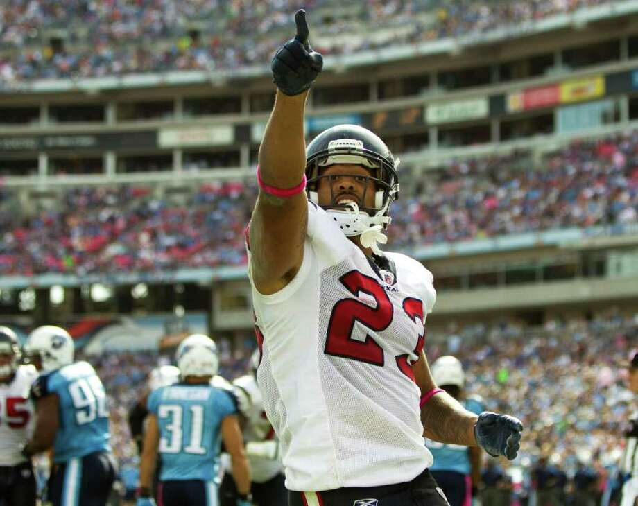 Houston Texans running back Arian Foster (23) celebrates after diving over the goal line for a 1-yard touchdown run against Tennessee Titans during the third quarter of an NFL football game at LP Field Sunday, Oct. 23, 2011, in Nashville. The Texans beat the Titans 41-7. Photo: Brett Coomer, Houston Chronicle / © 2011  Houston Chronicle